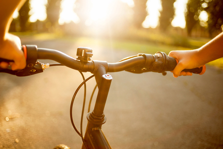 personal perspective: erson riding a bicycle on asphalt road Stock Photo