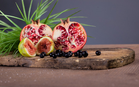 beautiful background of Pomegranate  fig and aronia
