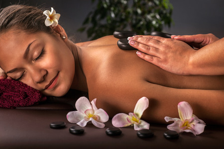 aroma therapy: Young, beautiful and healthy woman in spa salon. Traditional oriental aroma therapy and beauty treatments. Stock Photo