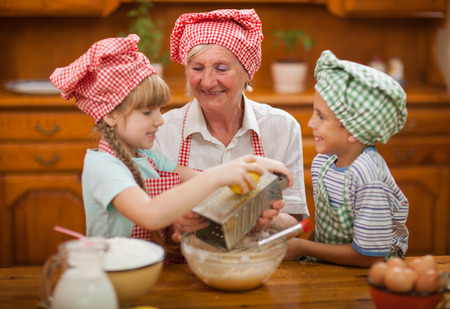 Grandmother with young kids In Kitchen