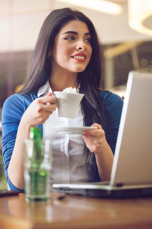 businesswear: young woman on coffee break