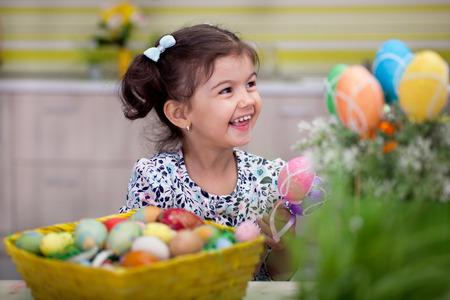 Little girl having fun with  Easter egg
