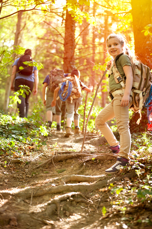 happynes: kids in green forest playing,concept of kids vacations and travel Stock Photo