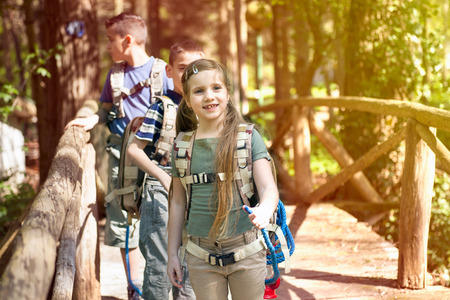 kids in green forest playing,concept of kids vacations and travel Standard-Bild