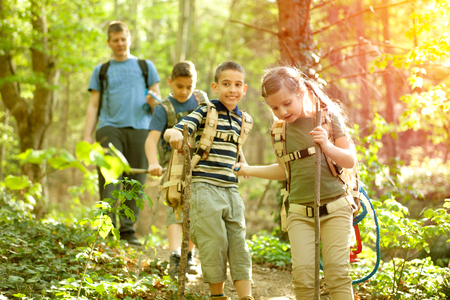kids in green forest playing,concept of kids vacations and travel Stock Photo