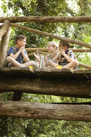happynes: happy childs in green forest playing,concept of kids vacations and travel Stock Photo