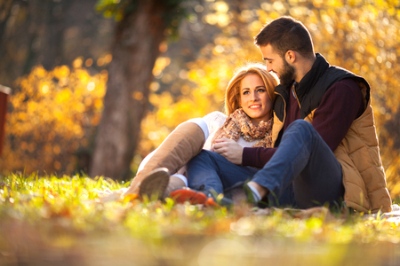 Beautiful couple in love in colorful park