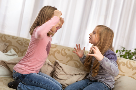 Conflict, bad relationships, friendship difficulties. Two young girls having argument