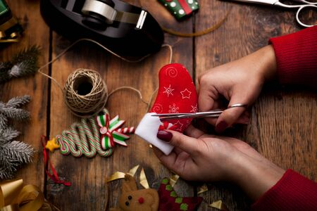 Christmas concept,woman making homemade gifts at home