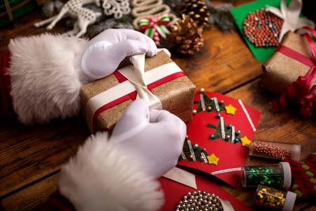 Santa Claus hands with gifts