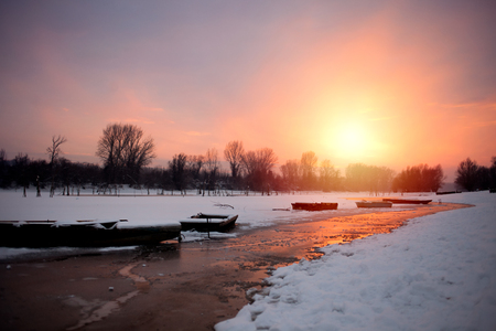 beautiful sunset in frosty evening at the river