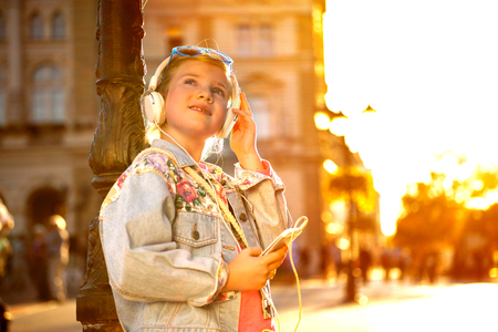 happy girl child listen to the music from her smartphone