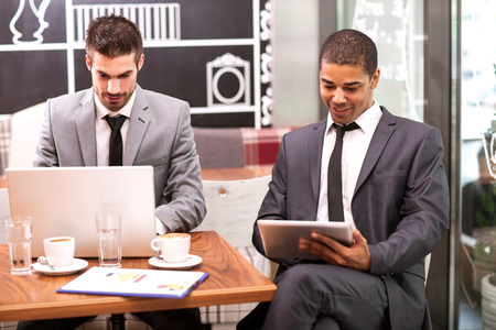 two young businessman in the coffee break