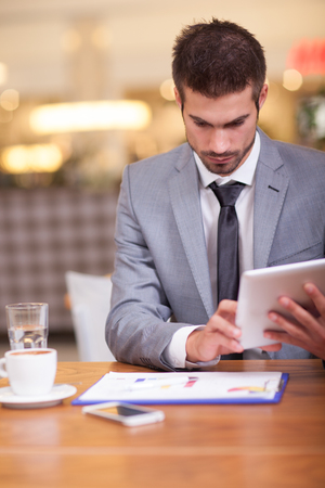 businessman working on break in coffee shop