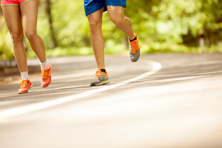 Young couple jogging at the woods