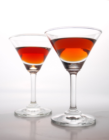 amber coloured: Two glasses of cognac isolated on a white background