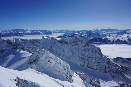 Alps over the clouds Stock Photo