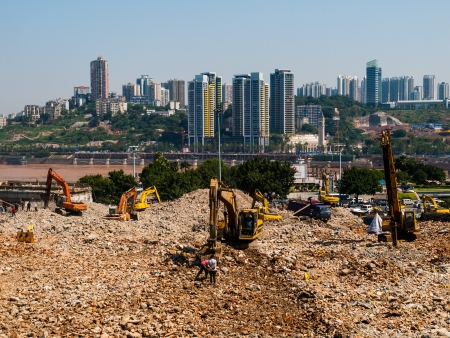 demolish: Excavators demolish old building  China  Editorial