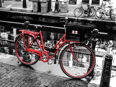 amsterdam canal: Red bicycle in Amsterdam  Netherlands  Stock Photo