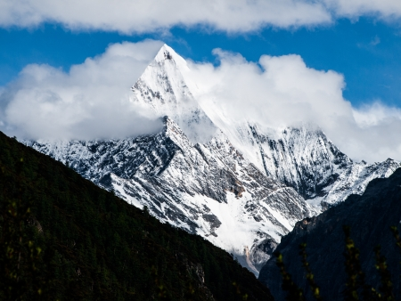 Dramatic weather at Chanadorje mountain in Yading nature reserve in Sichuan (China) photo