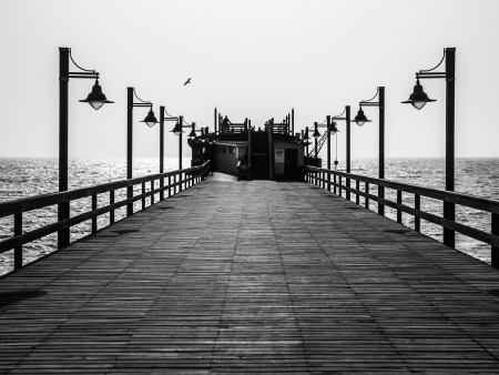 Pier with lamps in black and white (Swakopmund, Namibia) photo