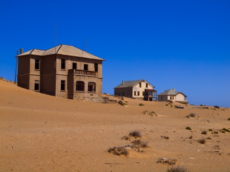 Sand in abandoned house in Kolmanskop ghost town (Namibia)