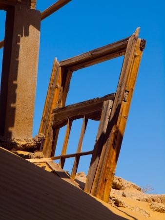 sand mold: Devasted door in Kolmanskop ghost town (Namibia) Stock Photo