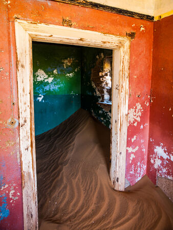 Sand in abandoned house in Kolmanskop ghost town (Namibia) photo