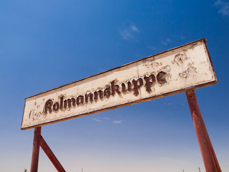 Kolmannskuppe signs in ghost town (Namibia) photo