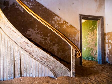 kolmanskop: Old staircase in Kolmanskop ghost town (Namibia)