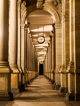 Mill colonnade with clock in Karlovy Vary at night (Czech Republic) photo