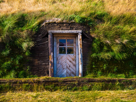 Door leading to typical grass house (Iceland) photo