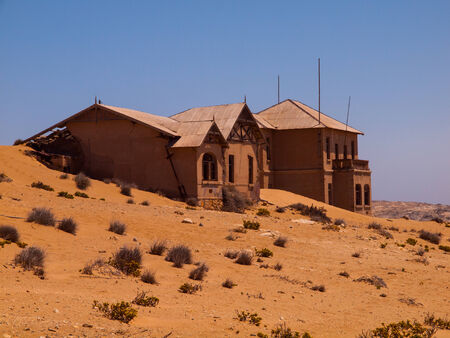 Abandoned house in Kolmanskop ghost village  Namibia  photo