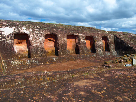 niches: Five niches in the rock in archeological site El fuerte of Samaipata (Bolivia) Stock Photo