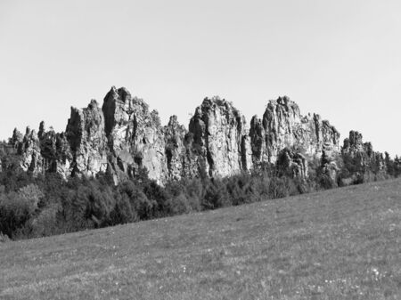 crack climbing: Sharp sand stone rock formation in black and white