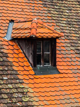 Old orange roof with retro dormer window photo