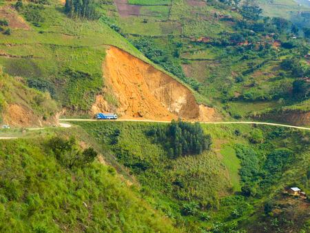 land slide: Landslides above the road in african mountains