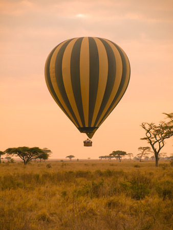 Hot air balloon landing in african savannah photo
