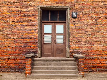 prison yard: Entrance door with steps to the brick building