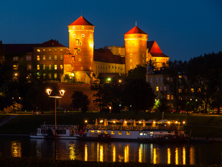 Wawel Castle and Vistula River in Krakow by night (Poland)