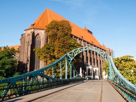 Tumski Bridge in Wroc�aw with a view of St. Marys Church (Poland) photo