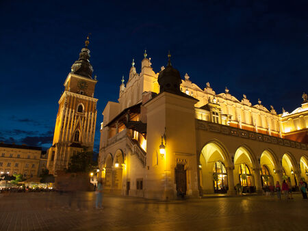 Sukiennice and Town Hall Tower in Krakow by night, Poland photo