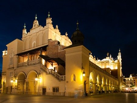 Sukiennice or Cloth Hall in Krakow by night, Poland photo