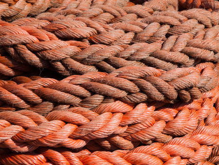 detailed view: Detailed view of red rope, nautical background Stock Photo