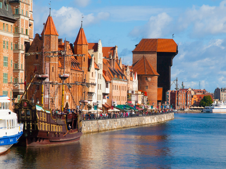 riverside: Motlawa riverside with historical buildings and crane, Poland, Gdansk Stock Photo
