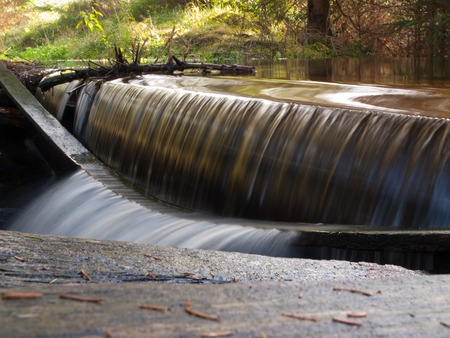 sluice: Small broken spillweir in the forest, long exposure