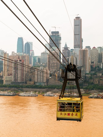 yangtze river: Cableway over muddy Yangtze River in Chongqing, China
