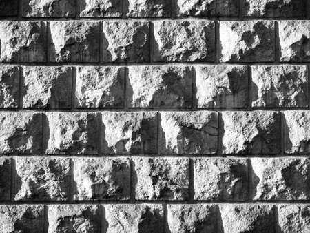 grey scale: Solid stone wall background texture, garden architecture, black and white image