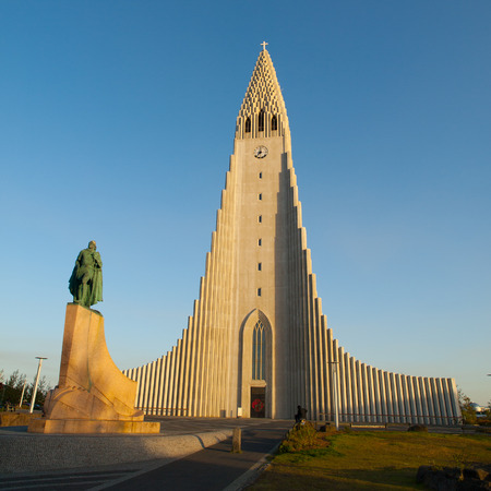 leif: White Lutheran Cathedral Hallgrimskirkja and Leif Ericsson statue in Reykjavik, Iceland
