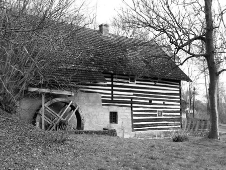 watermill: Old rural watermill with ancient water wheel, black and white image Stock Photo